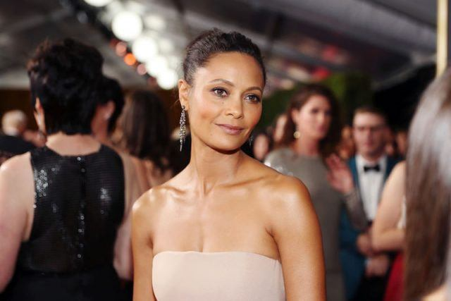 Thandie Newton wearing a nude strapless gown at a party.