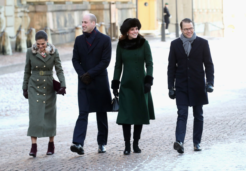 Crown Princess Victoria of Sweden, Prince William, Duke of Cambridge, Catherine, Duchess of Cambridge and Prince Daniel of Sweden walk through the cobbled streets of Stockholm