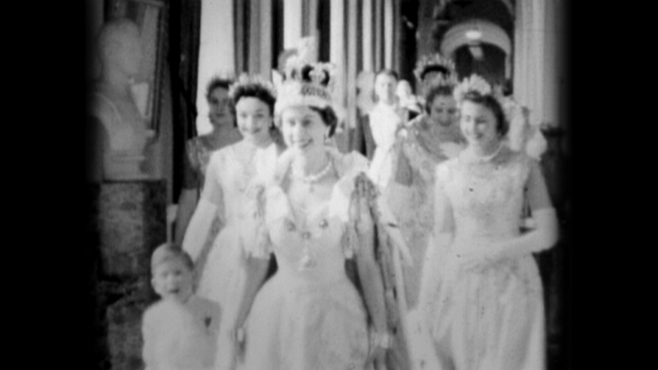 Queen Elizabeth II walks down the Principal Corridor with Prince Charles (L) on the day of her Coronation on June 02, 1953 in London, England