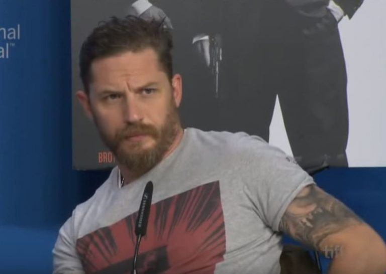 Tom Hardy conducting a press interview for his movie.