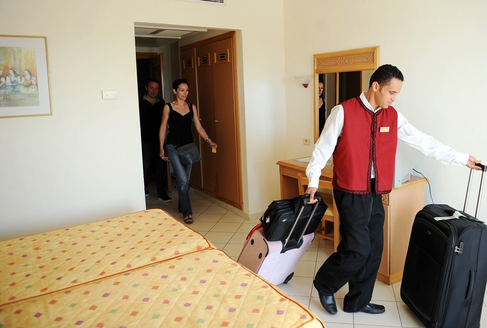 Tourists arrive in their hotel room