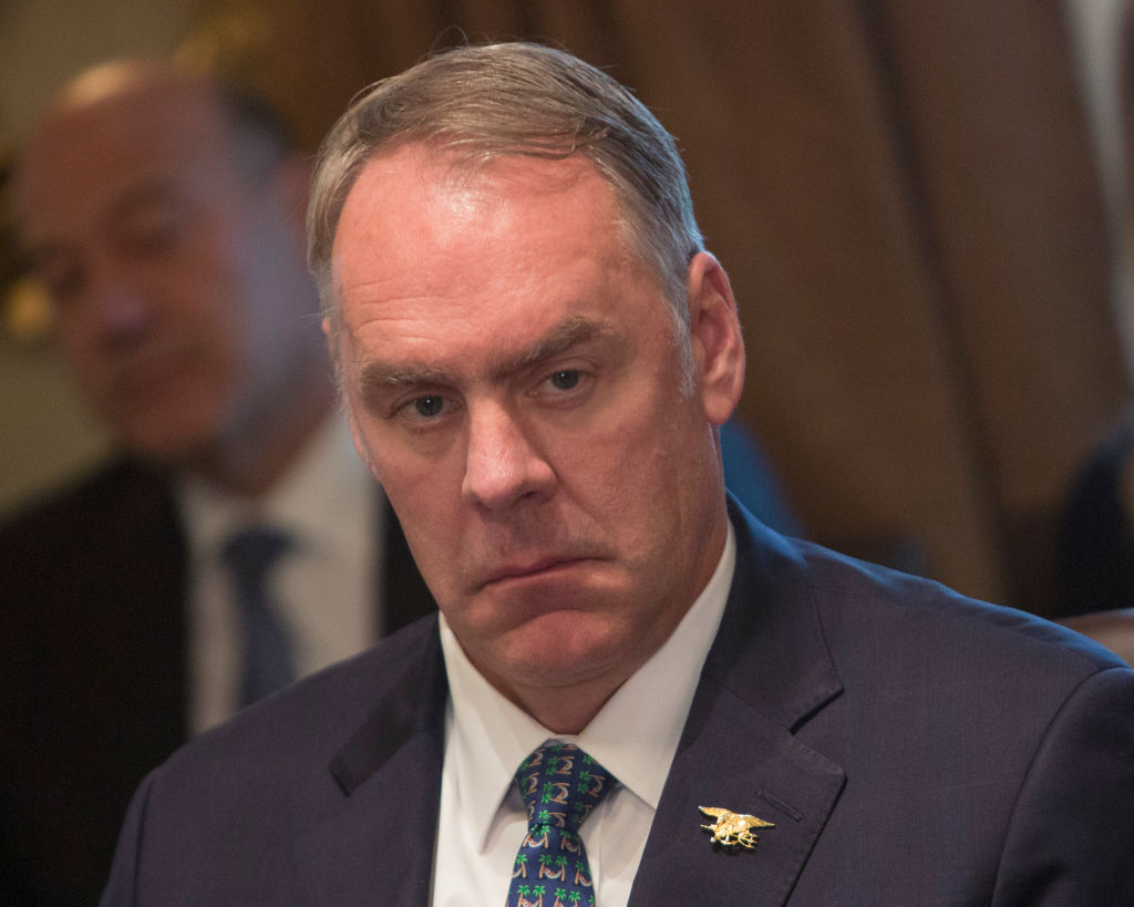 U.S. Secretary of the Interior Ryan Zinke listens during a Cabinet meeting