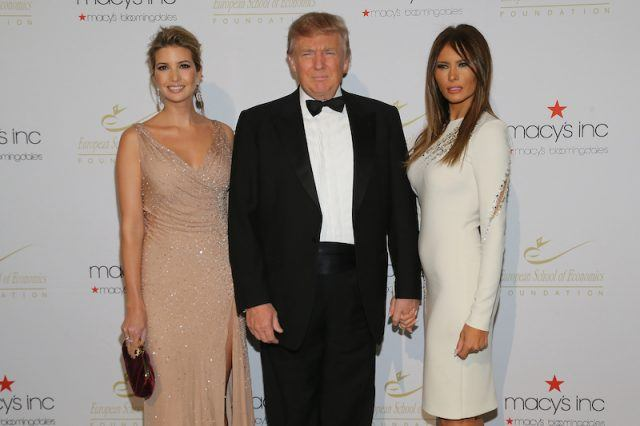 Donald standing with Ivanka and Melania.