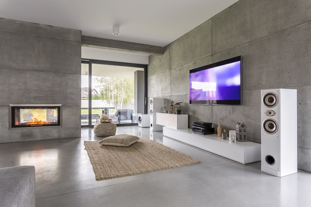 Tv living room with window, fireplace and concrete wall