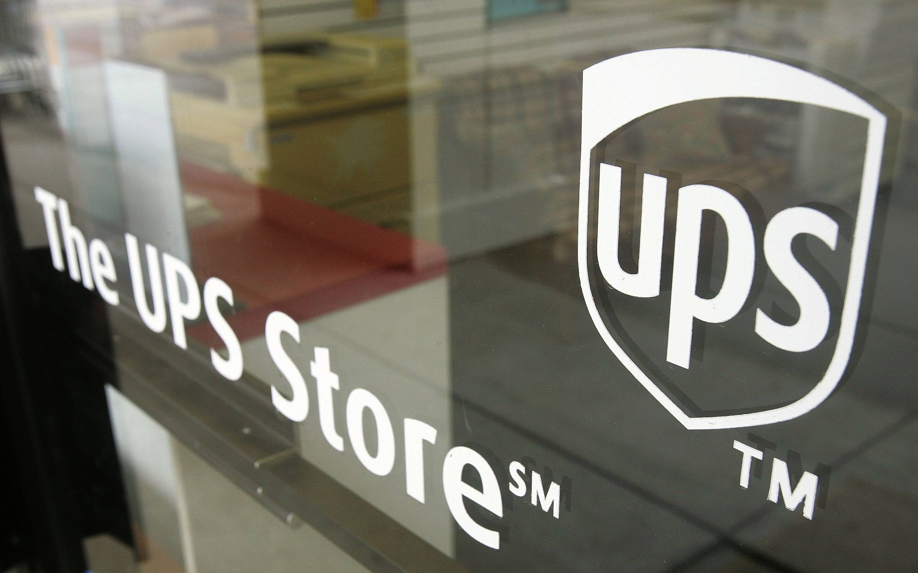A UPS Store sign is seen on a door