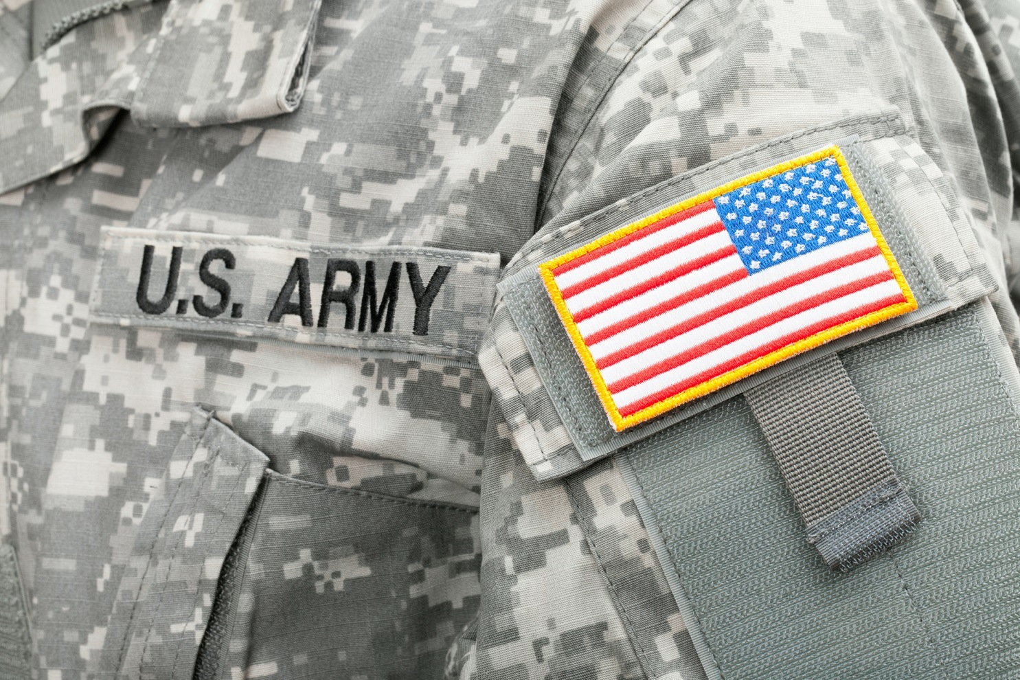 Close up studio shot of USA flag and U.S. ARMY patch on solders uniform