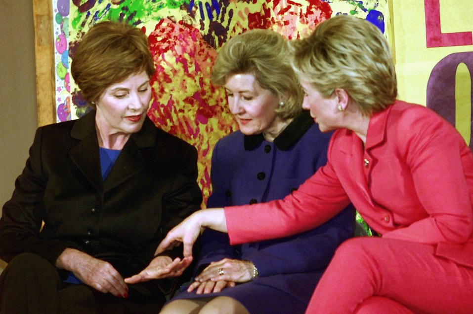 US First Lady Laura Bush shows her ring to US Senator Kay Bailey Hutchison and US Senator Hillary Clinton as they talk among themselves