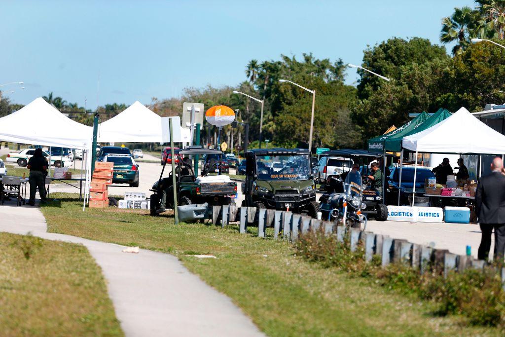 Police vehicles block the roadway to Marjory Stoneman Douglas High School in Parkland, Florida