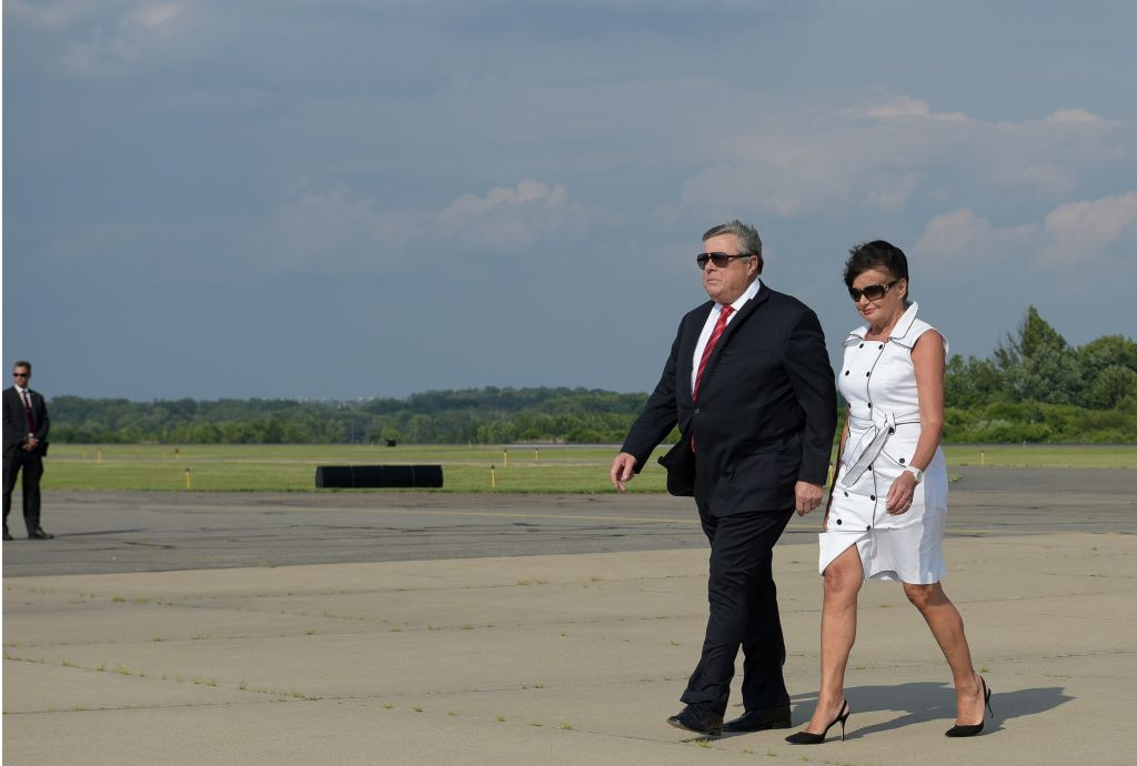 Viktor Knavs (L) and Amalija Knavs step off off Air Force One upon arrival in Morristown