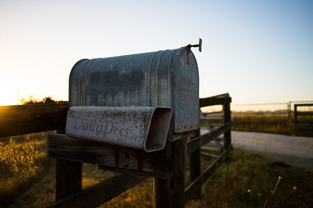 A metal, vintage mailbox with a slot for newspaper