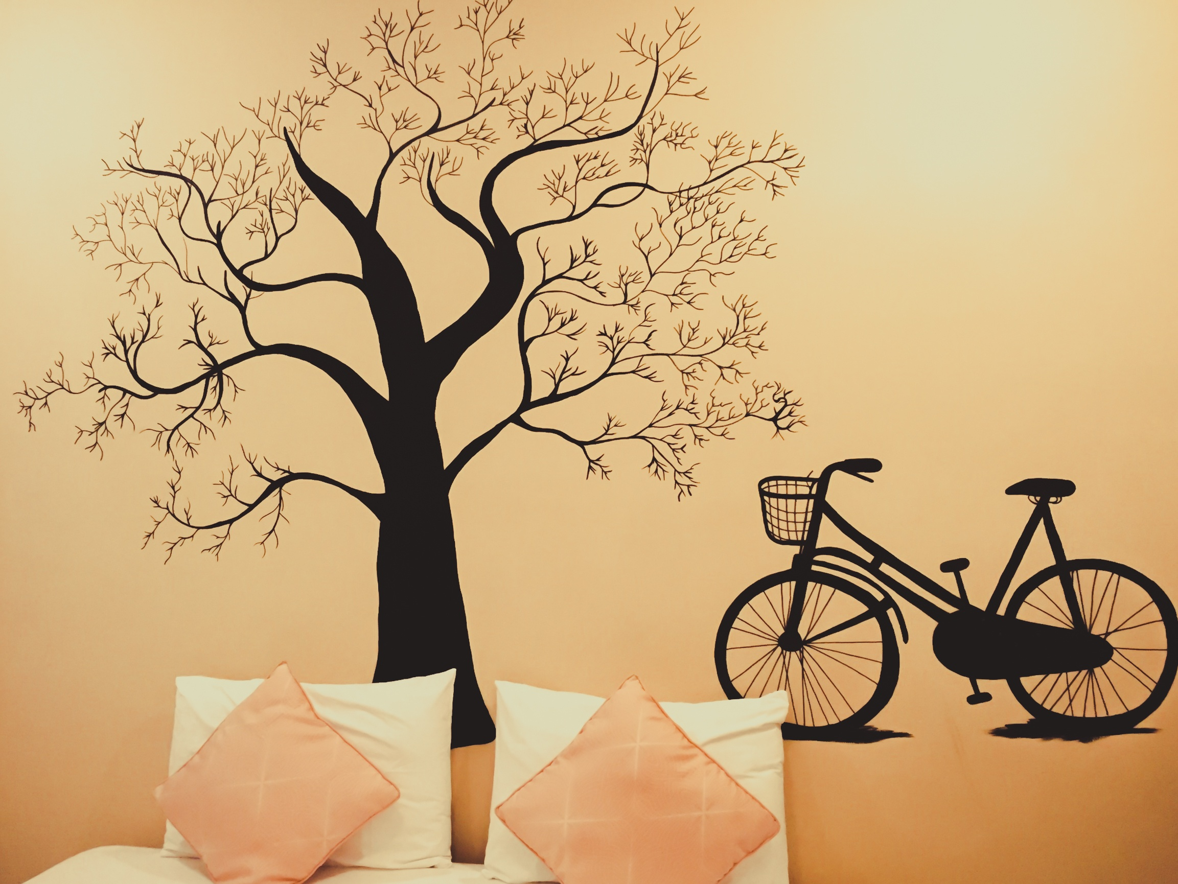 Black tree and bicycle wall sticker in the pink room