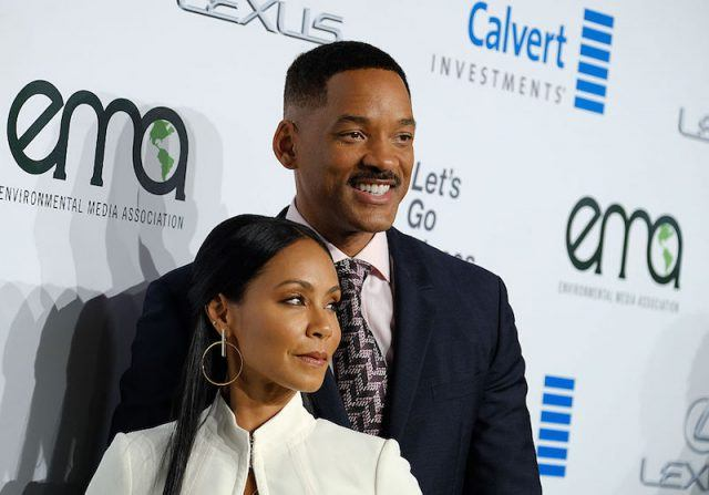 Jada Pinkett-Smith and Will Smith posing together on a red carpet.