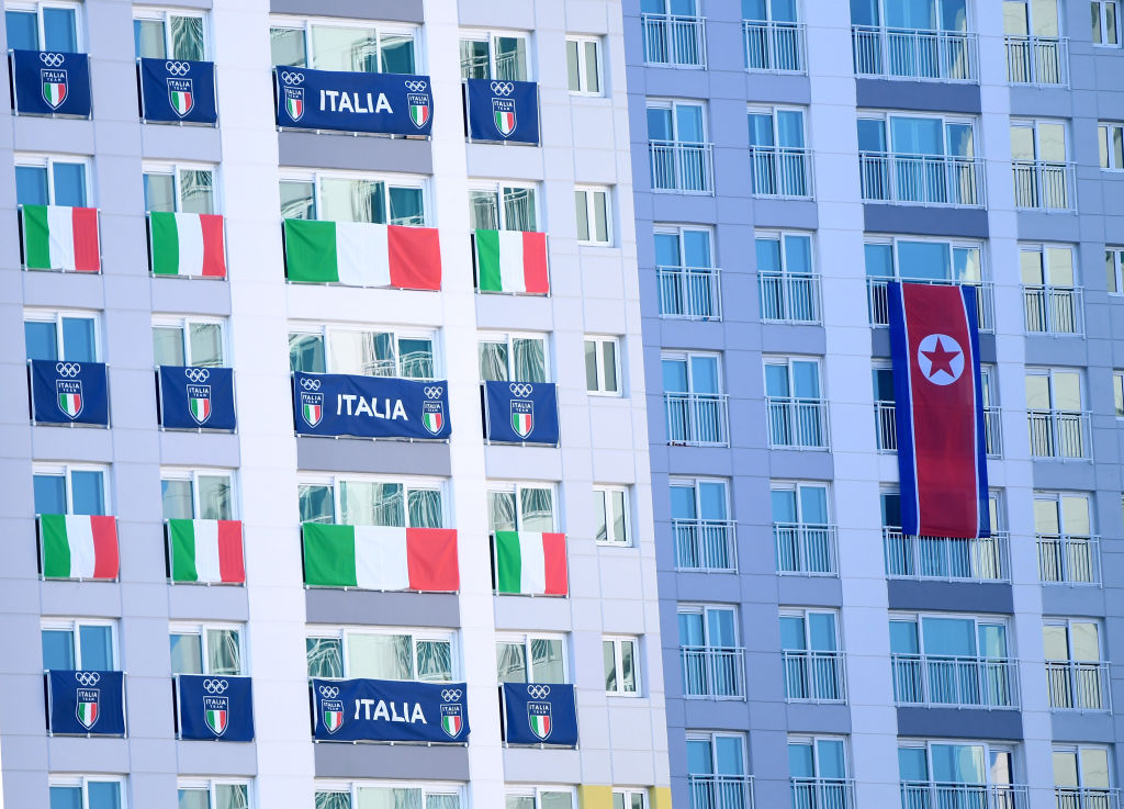 Flags in the windows of the athletes' village in Pyeongchang Olympics