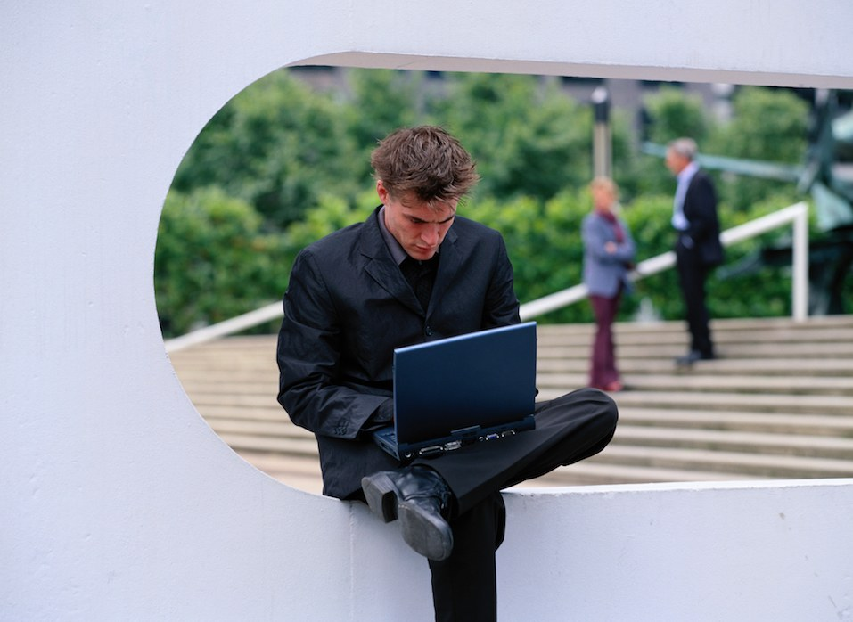 Young Businessman on Laptop Out