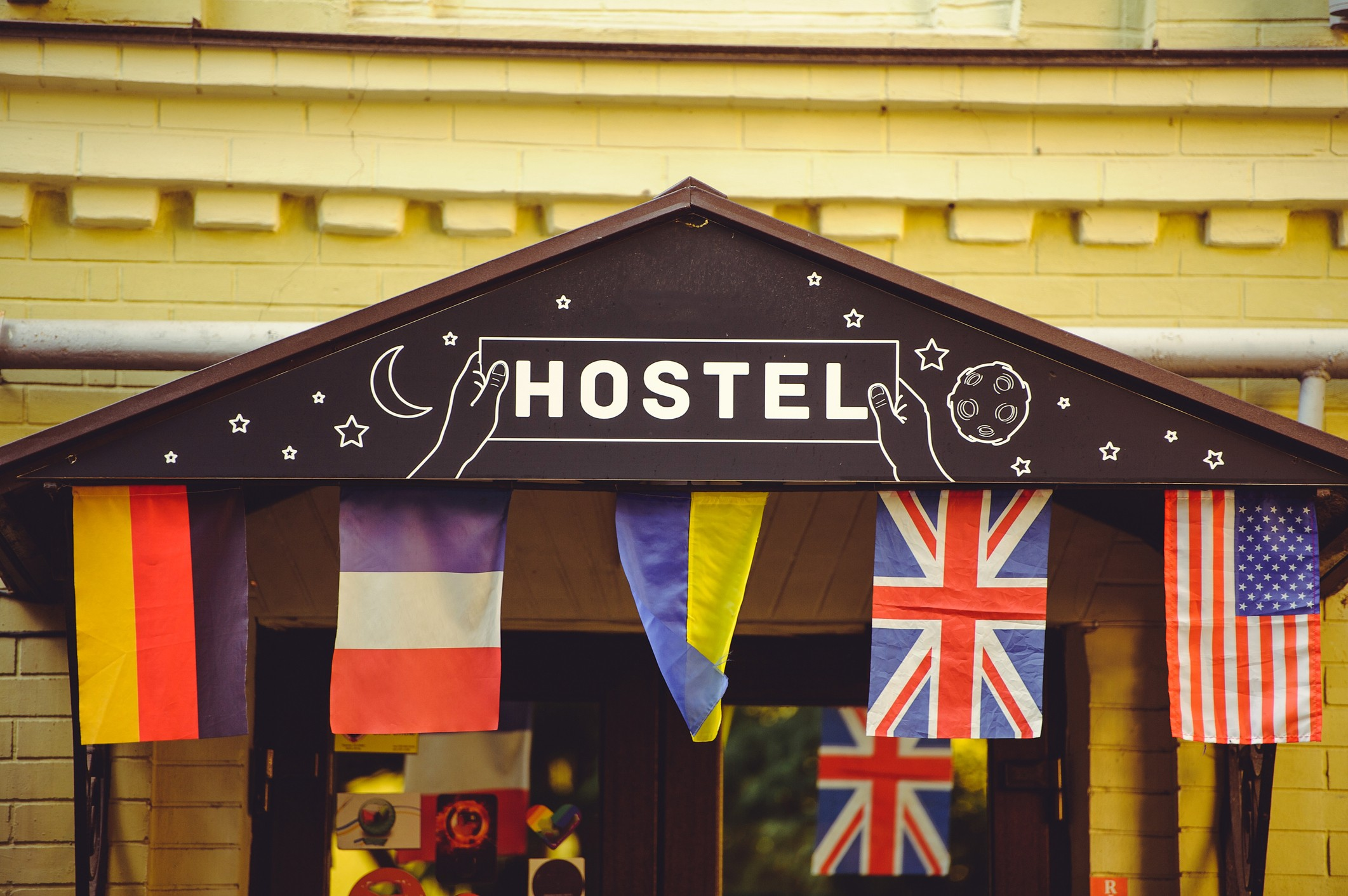 Sign for hostel displaying flags
