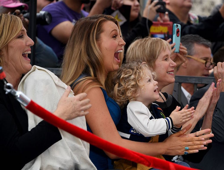 Blake Lively and her daughter James cheer at the Hollywood Walk of Fame ceremony honoring her husband actor Ryan Reynolds with a star in Hollywood, California on December 15, 2016.