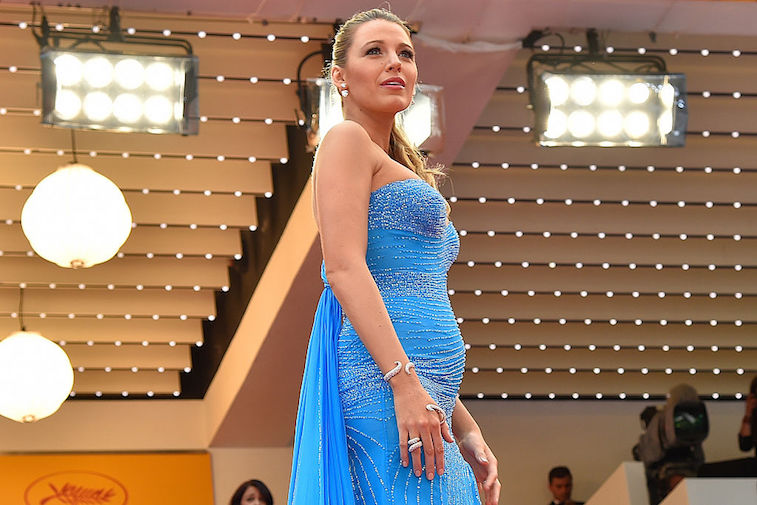 """US actress Blake Lively poses on May 14, 2016 as she arrives for the screening of the film """"The BFG"""" at the 69th Cannes Film Festival in Cannes, southern France."""