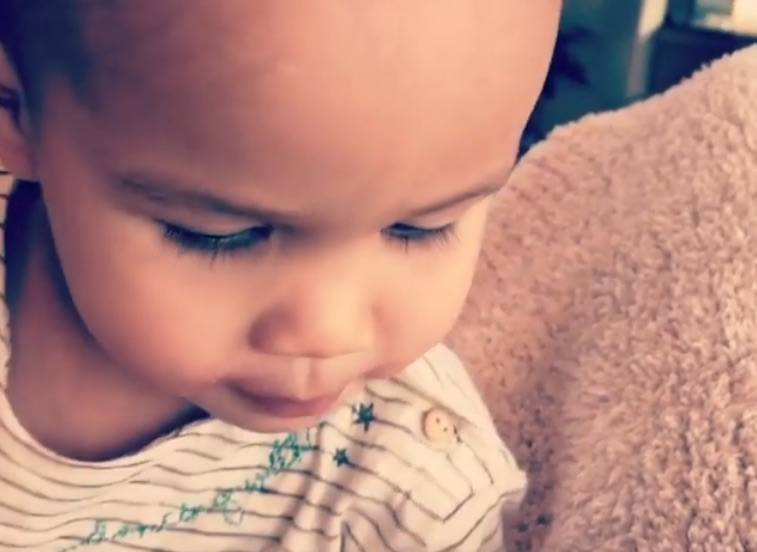 Chrissy Teigen's daughter Luna talking to Teigen's belly.