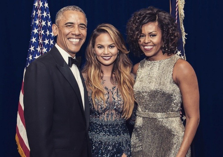 Chrissy Teigen posing with Barack and Michelle Obama