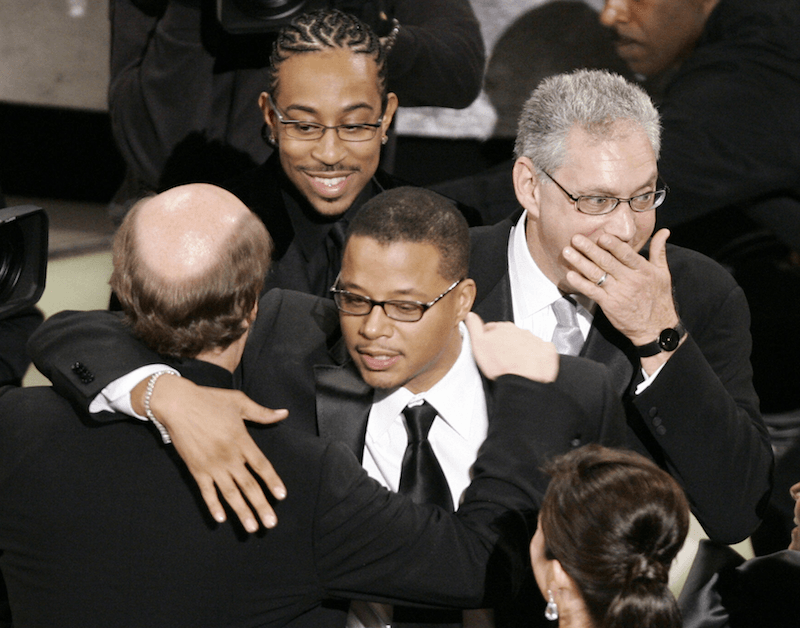 Los Angeles, UNITED STATES: Members of 'Crash' react after winning Best Picture 05 March 2006 during the 78th Academy Awards at the Kodak Theater in Hollywood, California. AFP PHOTO/Timothy A. CLARY (Photo credit should read TIMOTHY A. CLARY/AFP/Getty Images)