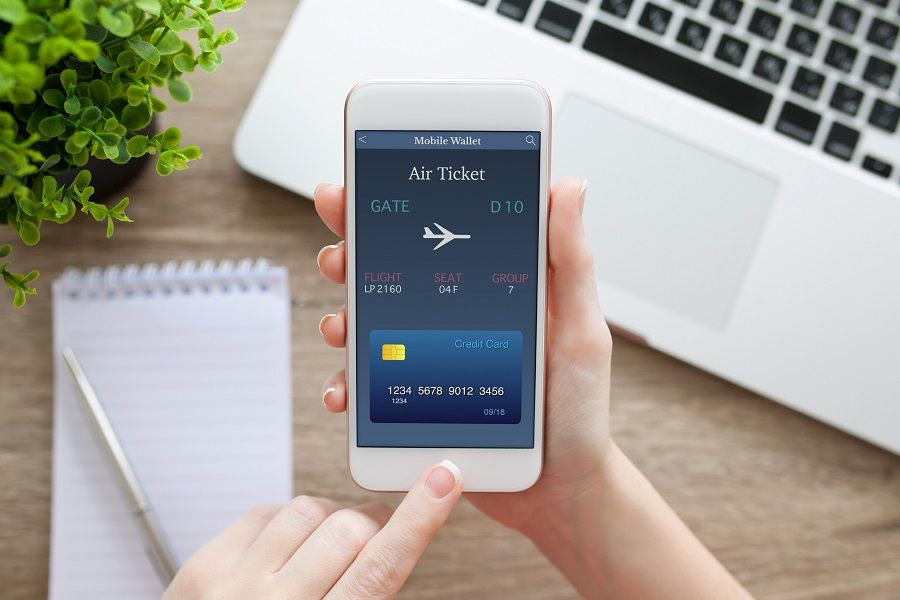 hand holding white phone with online air ticket