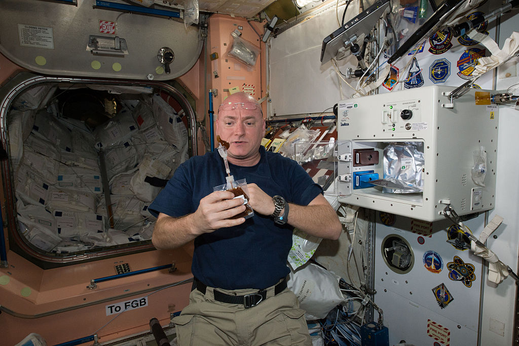 NASA astronaut Scott Kelly enjoys his first drink from the new ISSpresso machine
