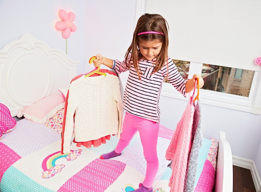 Girl choosing clothes to wear