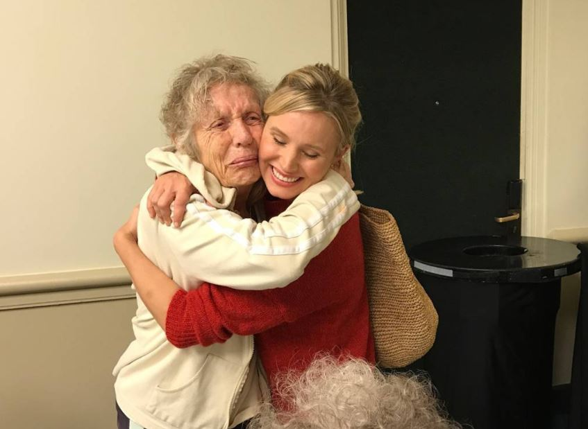 Kristen Bell and an elderly woman during Hurricane Irma