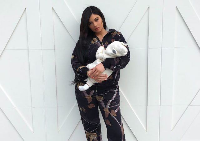 Kylie Jenner holds baby Stormi.