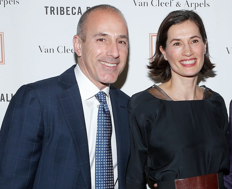 Matt Lauer and his wife smile at an event