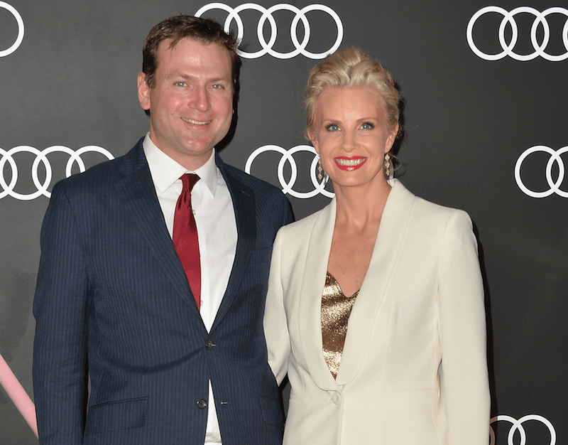 Daniel Christopher Allison and Monica Potter smiling and posing for photographers.