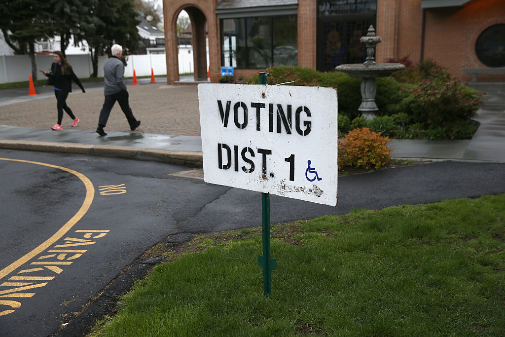 A voter arrives to cast her ballot at a polling center in Stamford, Connecticut.