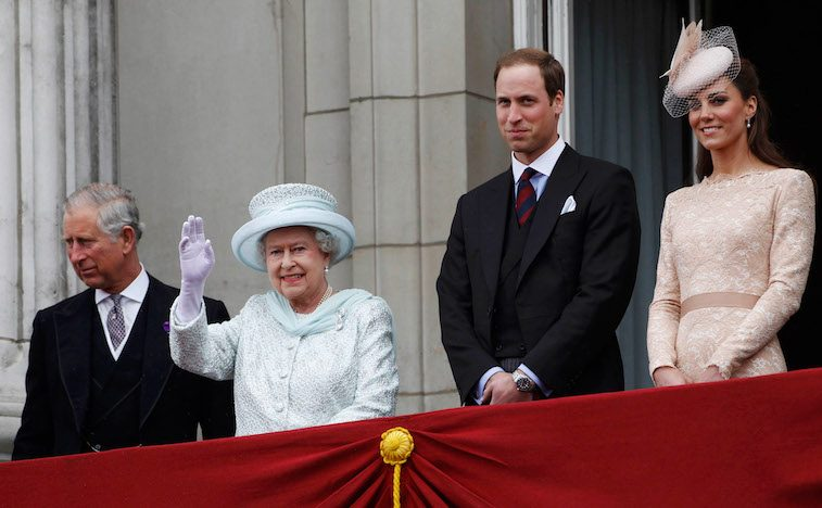 Britain's Queen Elizabeth waves from the balcony of Buckingham Palace as Prince Charles (L), Prince William (2nd R) and Catherine, Duchess of Cambridge (R), look on, during her Diamond Jubilee in central London June 5, 2012. Cheering crowds thronged the streets of London on Tuesday for the grand finale to four days of festivities marking Queen Elizabeth's Diamond Jubilee attended by millions across Britain.