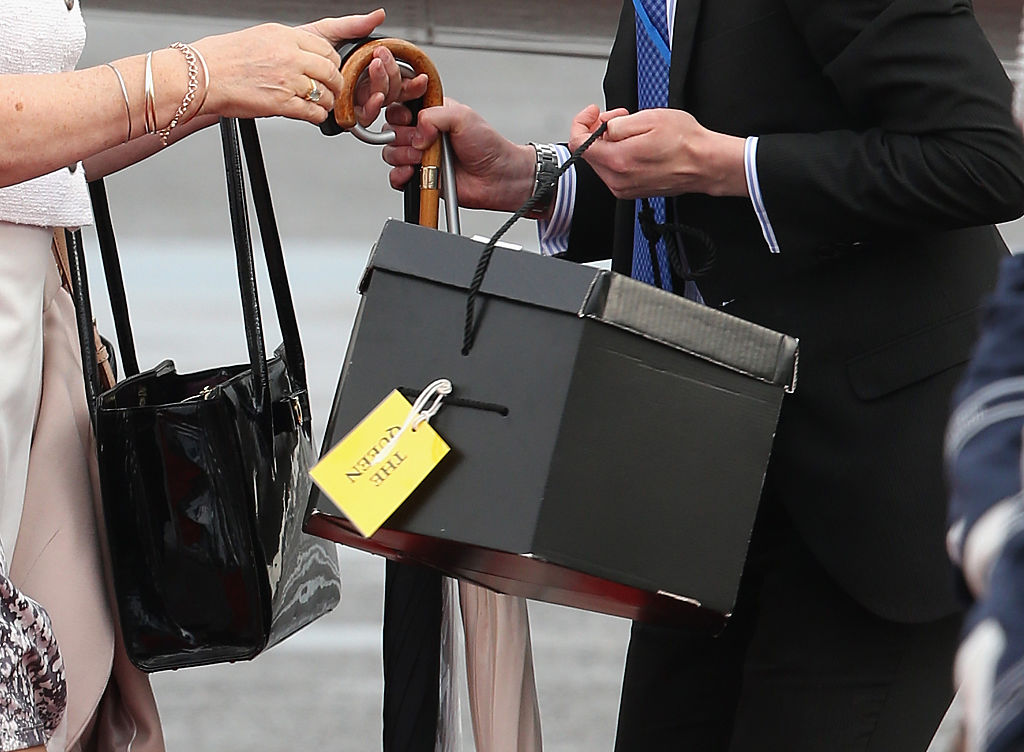 Staff carry luggage off the plane as Queen Elizabeth II and Prince Philip, Duke of Edinburgh arrive at Berlin Tegel Airport for a four day State Visit on June 23, 2015 in Berlin, Germany. The Queen and Prince Philip are scheduled to visit Berlin, Frankfurt and the concentration camp memorial at Bergen-Belsen during their trip, which is their first since 2004.