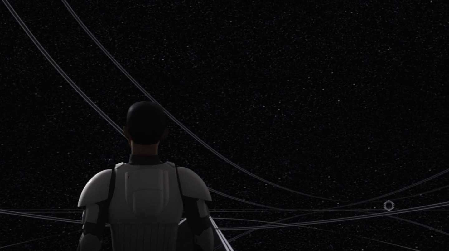 Ezra stands and stares outward into a black starry sky.