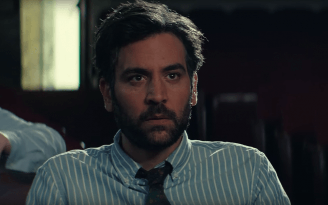 Josh Radnor sits in a striped shirt and tie in 'Rise'.