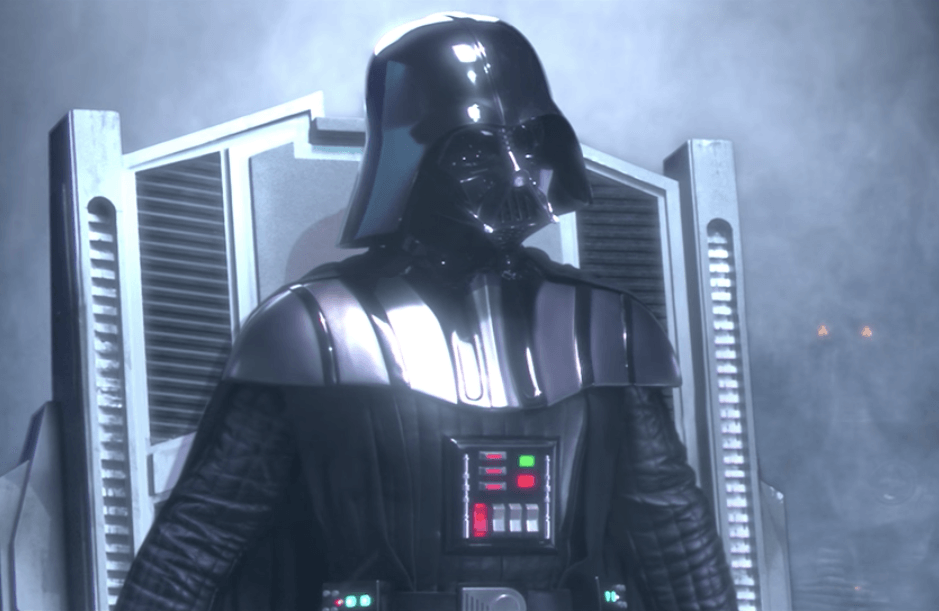 Darth Vader siting on a silver throne.