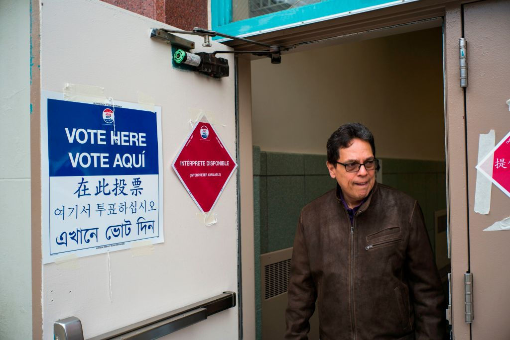 A man leaves after casting his vote at a polling station in New York