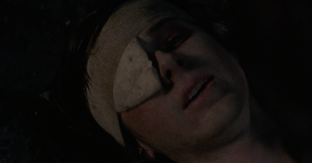 """In 'The Walking Dead' episode, """"Honor,"""" Carl lays dying on the ground as he speaks to his father."""