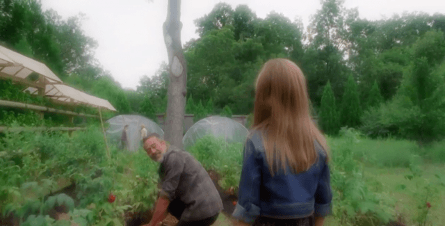 In a scene from 'The Walking Dead' episode 'Honor,' Judith greets a smiling Negan as he works in the garden.