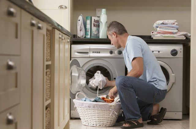 A man does the laundry.