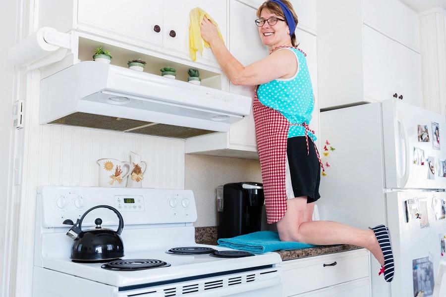 woman on her knees on white kitchen