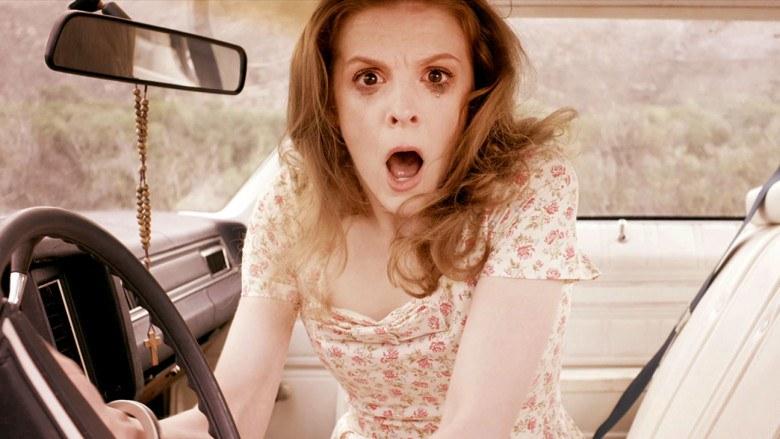 A woman screams in a car