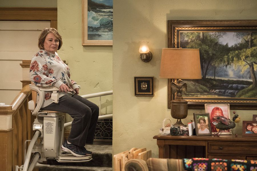 Roseanne on a chair