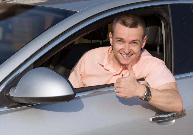 A driver giving a thumbs up.