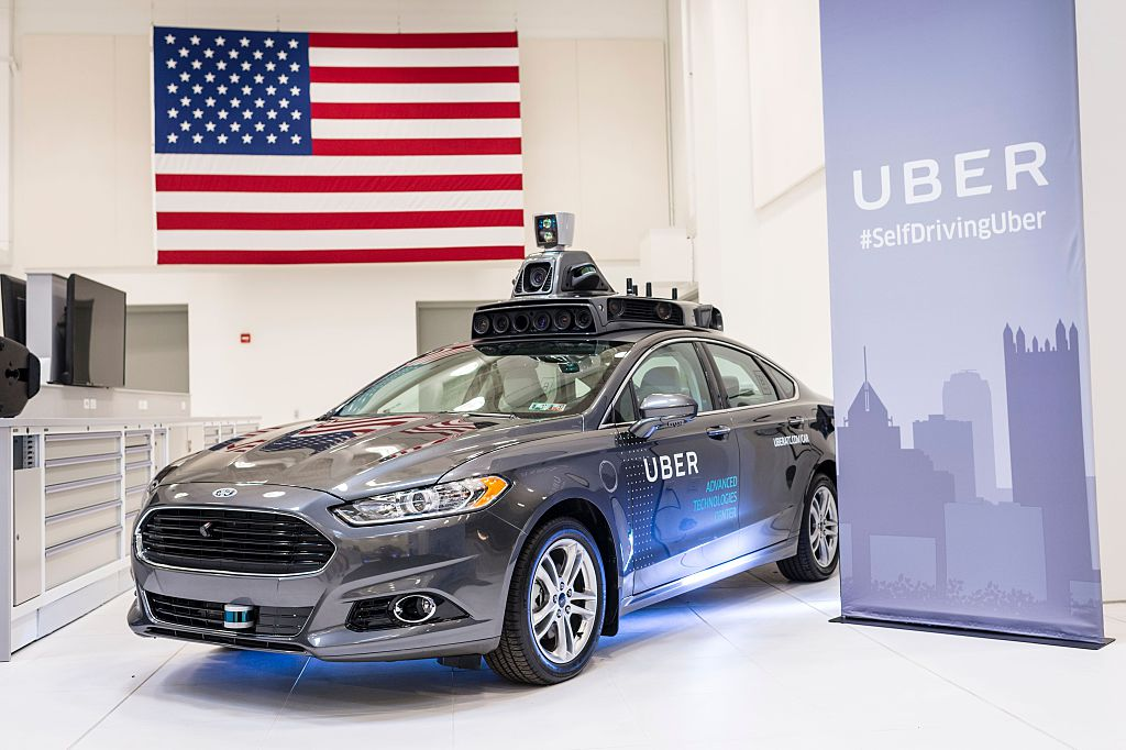 A pilot model Uber self-driving car is displayed at the Uber Advanced Technologies Center