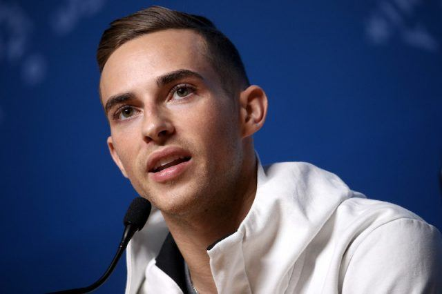 Adam Rippon speaking at a press conference.