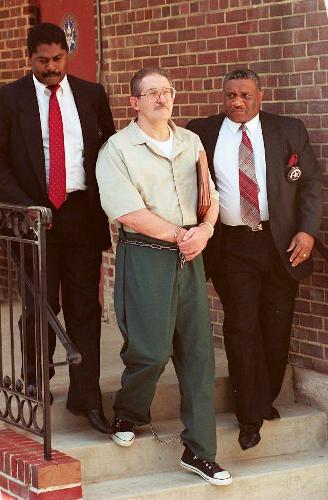 US marshalls escort Aldrich Ames (C) out of federal court