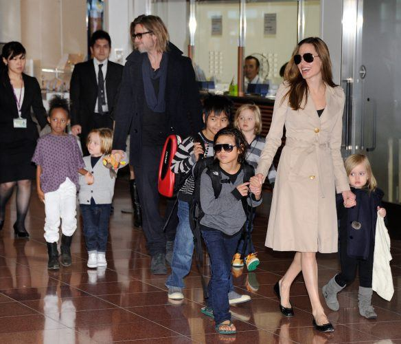 Angelina Jolie and Brad Pitt at the airport with their kids