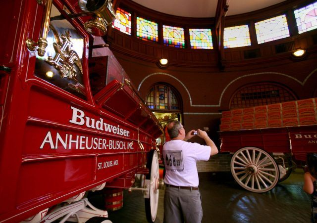 A visitor take a photo inside a stable for the Budweiser Clydesdales